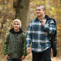 Man and son walking in the woods