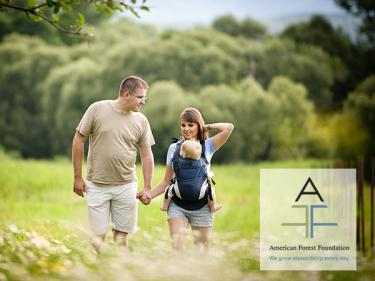 family walking in woods with AFF logo